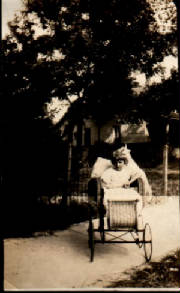 Picture of blond girl in wicker wheelchair